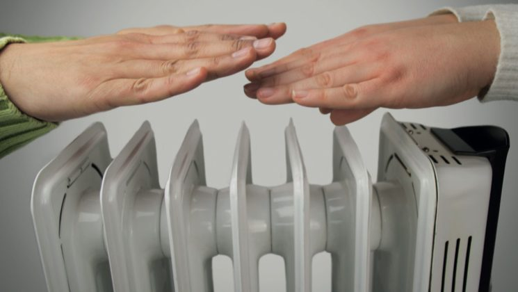 Hands over a radiator Original image - https://unison-scotland.org/winter-fuel-grant-2019-20/